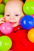 Cheerful Baby With Balls