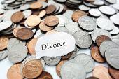 stock photo of divorce-papers  - Divorce text on a pile of coins - JPG