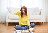 education concept - stressed student girl reading books at home