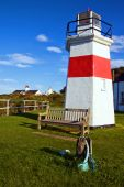 Capture Of Lighthouse With Wooden Seat