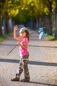 foto of say goodbye  - little kid with hobo stick bag and bundle girl saying goodbye with hand - JPG