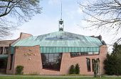 NETHERLANDS - EXLOO - CIRCA APRIL 2014: City hall of Exloo with copper roof.
