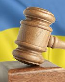 Vintage wooden gavel and flag Ukraine