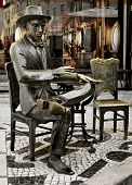 LISBON, PORTUGAL - MARCH 18: Statue of Fernando Pessoa outside of Cafe A Brasileira on March 18, 2014 in Lisbon, Portugal. This iconic statue and the cafe itself are visited for thousands of tourists