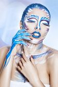 Beautiful Girl With Blue Shiny Lips.