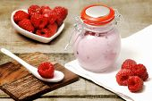 Raspberry Jogurt In Jar With Fresh Fruits