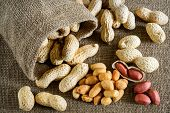 foto of testis  - Peeled peanut on well peanuts in background - JPG