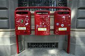BOLOGNA, ITALY - APRIL 19, 2014: Three postal boxes in Bologna, Italy, on Saturday, April 19, 2014.