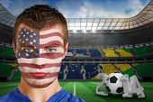 Composite image of serious young usa fan with facepaint against large football stadium