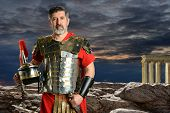 Portrait of Roman Centurion outdoors in front of rocks