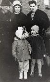 Poland, circa 1964: Polish family posing for a photograph outdoors, circa 1964