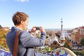 picture of gaudi barcelona  - Tourist man taking photo in with smartphone in Park Guell - JPG