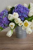 white tulips and blue hortensia flowers