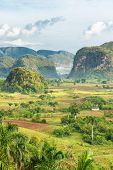 View of the Vinales Valley in Cuba on the early morning with clouds and mist floating among the moun