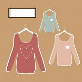 three beautiful blouses on hangers in retro style vector.