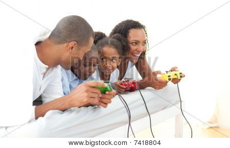 poster of Lively Family Playing Video Game Lying Down On Bed