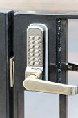stock photo of combination lock  - Electronic lock with pin code at fence - JPG