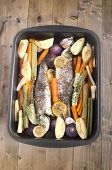 stock photo of turnips  - cooked sea bass with turnip potato carrot lemon and thmye in an aluminium roaster - JPG