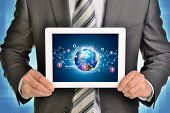 Man hands using tablet pc. Image of Earth and network on screen