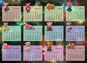 Calendar on 2007 year (magnetic pig for each month), xmas tree on background