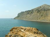 Orange rock and lagoon in Crimea