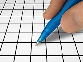 Pen in hand and crossword (closeup), clipping path for hand