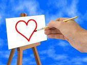 Hand with brush, red heart on easel
