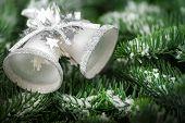 Silver Christmas Bells On Fir Twigs