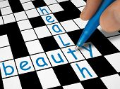 Crossword - beauty and health, hand with pen
