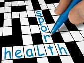 Crossword - health and sport, hand with pen