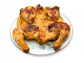 Roasted chicken on plate, isolated on white (clipping path)