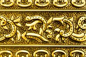 Pattern on yellow metal (retro textured background)