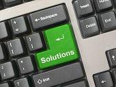 Computer keyboard - green key Solutions, close-up