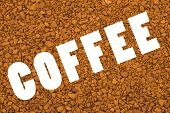 Word Coffee on brown granular background