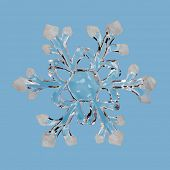 Ice snowflake, isolated on blue background