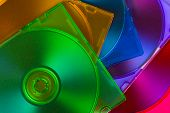 Computer disks in multiciolored boxes, technology background