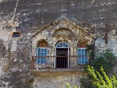 Old house inside rock, stone wall