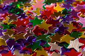 Mulicolored stars, abstract holiday background