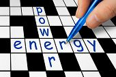 Hand filling in crossword - power and energy