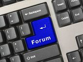 Computer keyboard -  blue key Forum, internet concept