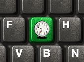 Computer keyboard with alarm clock key, business concept