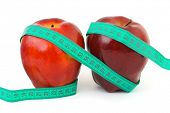 Two apples and measuring tape isolated on white background