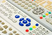 Group of tv remote controls, abstract technology background