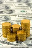 Stacks of coins on money, abstract business background