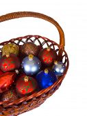 Basket with christmas balls isolated on white background
