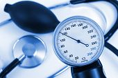 Scale of pressure and stethoscope, abstract medical background