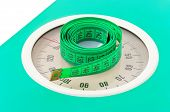 Measuring tape on weight scale, health slimming background