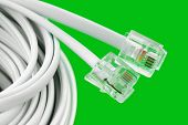 Macro of telephone cable on green background