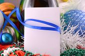 Christmas Background With Wine Bottle Pearls And Empty Paper Note