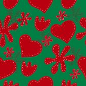 Seamless pattern of red hearts and flowers on a green background.
